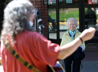 Some of the seniors attending Chris Ridout's performane at Parkwood Manor in Coquitlam are more than 100 years old. Photo by MARIO BARTEL/THE TRI-CITY NEWS