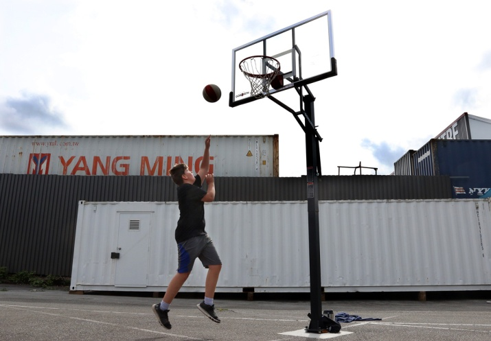 MARIO BARTEL/THE TRI-CITY NEWS A player at one of the Panther Hoops basketball camps goes for a layup on makeshift courts prepared by parent volunteers in the back parking lot of BC Christian Academy in Coquitlam.