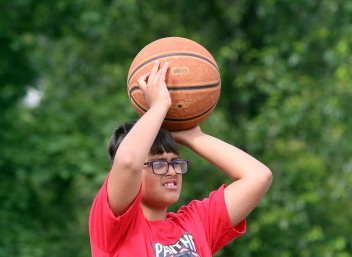 MARIO BARTEL/THE TRI-CITY NEWS Domenico Petroziello gets set for shot at Panther Hoops basketball camp, which is being held outdoors on a parking lot as most gyms and community centres are still closed because of the COVID-19 pandemic.