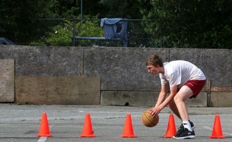 MARIO BARTEL/THE TRI-CITY NEWS Will Patterson works on an agility drill at Panther Hoops basketball camp that is being held on makeshift courts assembled in the back parking lot of BC Christian Academy in Coquitlam.
