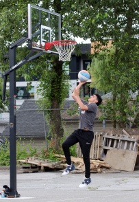 MARIO BARTEL/THE TRI-CITY NEWS Panther Hoops instructor Jakob Current drives to the basket at the urban outdoor courtyard behind BC Christian Academy in Coquitlam.