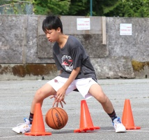 MARIO BARTEL/THE TRI-CITY NEWS A player at Panther Hoops basketball camp dribbles his way around pylons. To keep space between the young athletes, the emphasis is on individual skill development.